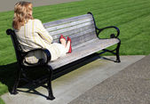 Relaxing on a bench outdoors. — Stock Photo