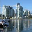 Vancouver BC.,skyline & False Creek river and sailboats. - Stock Photo