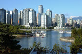 Vancouver BC south waterfront skyline & sailboats. — Stockfoto