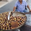 Roasted chestnuts for sale - Stock Photo