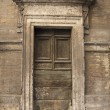 Weathered Roman door — Stock Photo