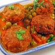 meatballs in sauce with peas — Stock Photo