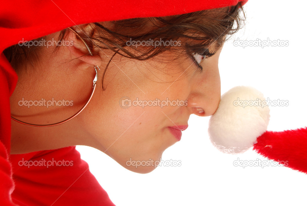 A beautiful girl with the hat of Santa Claus — Photo #6747534