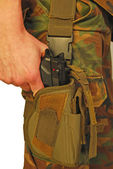 Uniformed soldier draws his gun from the holster - it is war — Stock Photo