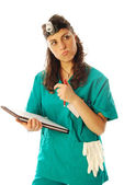 Woman doctor fill out the diagnosis of a patient — Stock Photo