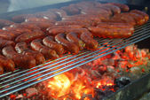 Grilled sausages for all — Stock Photo