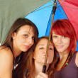 Friends under the umbrella — Stock Photo