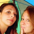 Two friends under the umbrella — Stock Photo