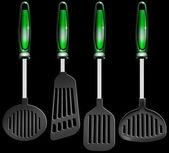 Kitchen utensils on black — Stock Photo