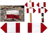 Red and white signposts — Photo