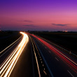 Cars speeding on a highway — Stock Photo
