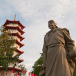 Historical statue and pagoda — Stock Photo