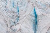 Cracks in glacier ice sheet — Stock Photo