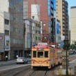 Electric tram on street — Stock Photo