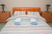 Simple hostel or hotel bedroom — Stock Photo