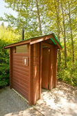Small toilet hut — 图库照片