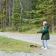 Senior male practising qigong — Photo