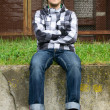 Young handsome man sitting near the old building — Stock Photo #7191001