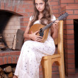 Girl playing on Mandolin — Stockfoto