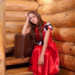 Girl in red spanish dress sitting on stairs — Stock Photo