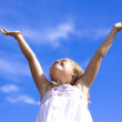 Girl touching the sky - Stock Photo