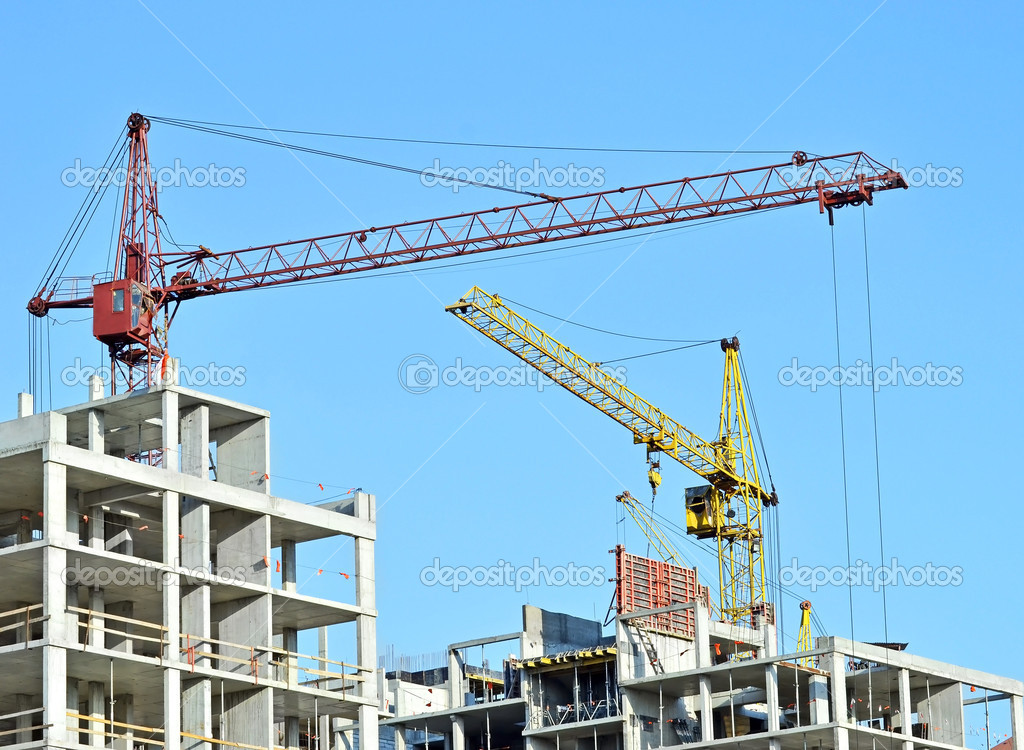 Crane and building construction site against blue sky — Stock Photo #6751369