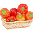 Red pepper in a wattled basket - Stock Photo