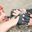 The help two rock-climbers each other in outdoor - Stock Photo