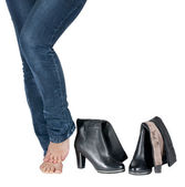 Beautiful female legs and boots isolated — Stock Photo