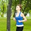 Young woman jogging in the park in summer — Stock Photo #6802226