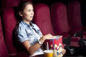 Woman at the cinema eat popcorn — Stock Photo