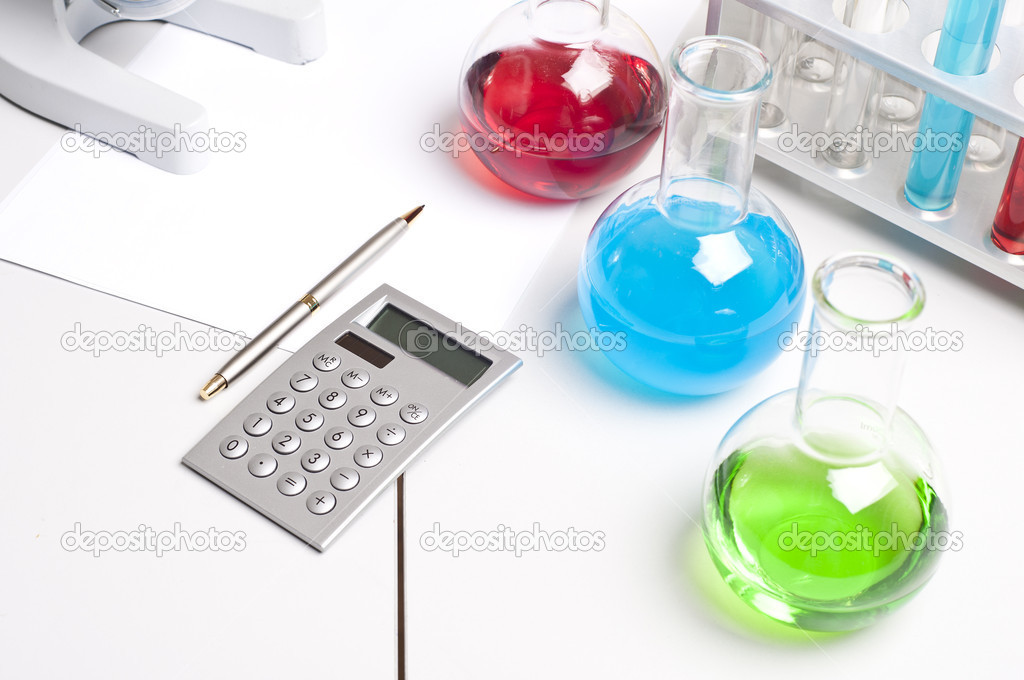 Workplace employee lab,flasks with colored liquids, laboratory items — Stock Photo #6802558
