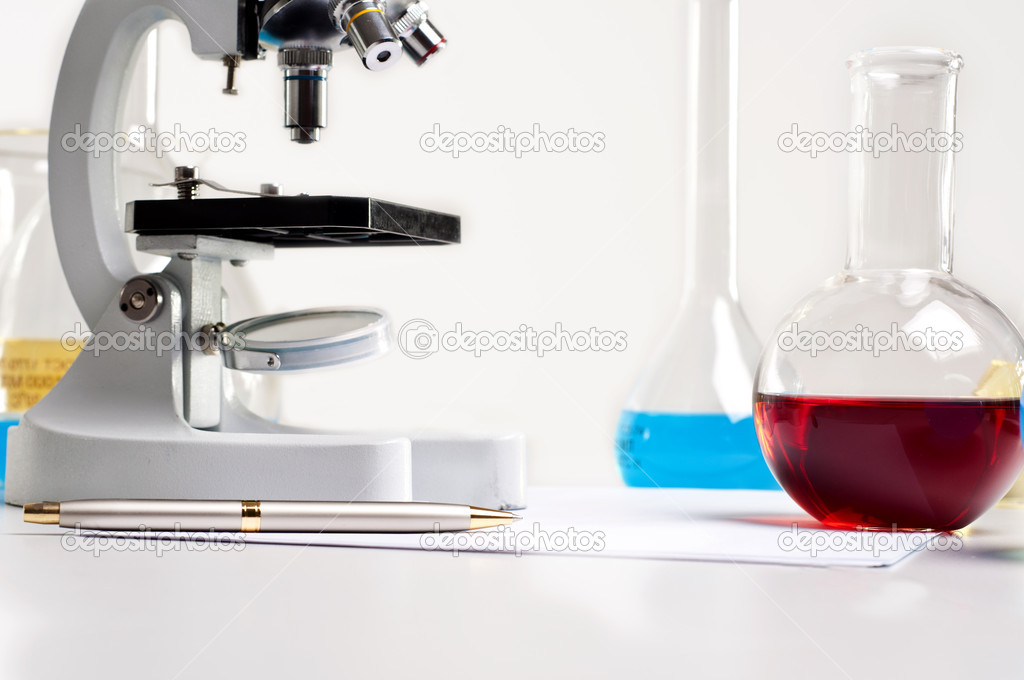 Workplace employee lab,flasks with colored liquids, laboratory items — Stock fotografie #6802654