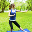Stock Photo: Yoga woman on green grass
