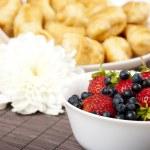 Постер, плакат: Breakfast milk croissants and Berries on a table