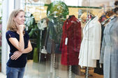Beautiful woman looks at the clothes — Stock Photo