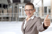 Businesswoman showing his thumb up with smile — Foto de Stock