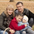 Young family in autumn park — Stock Photo #7518316