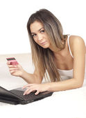Nice woman pays for online shopping — Stock Photo