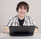Student sits for a portable computer — Stock Photo