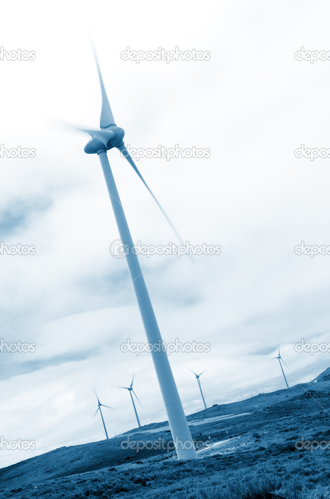 Wind turbines in a wind farm producing renewable power supply — Stock Photo #6969209