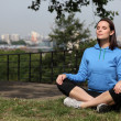Beautiful fit girl meditating in warm sunshine — Stock Photo