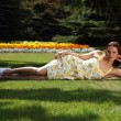 Sexy young woman tanning in garden summer sun — Stock Photo