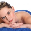 Young woman lying on health spa massage table — Stock Photo