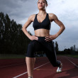Athlete warm up stretch on athletics running track — Stock Photo