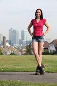 Beautiful woman roller skating in London England — Stock Photo