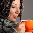 Young woman in warm winter hat drinking hot tea — Stock Photo