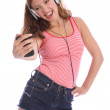 Teenage girl singing to music from her cell phone — Stock Photo