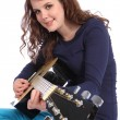 Teenager girl musician playing acoustic guitar — Stock Photo