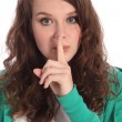 Teenager girl with blue eyes keeping a secret — Stock Photo